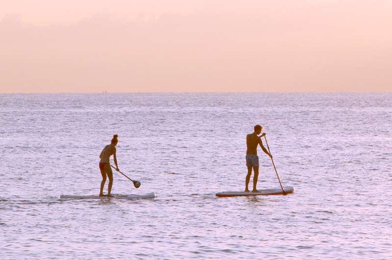 paddle boarding pett level beach